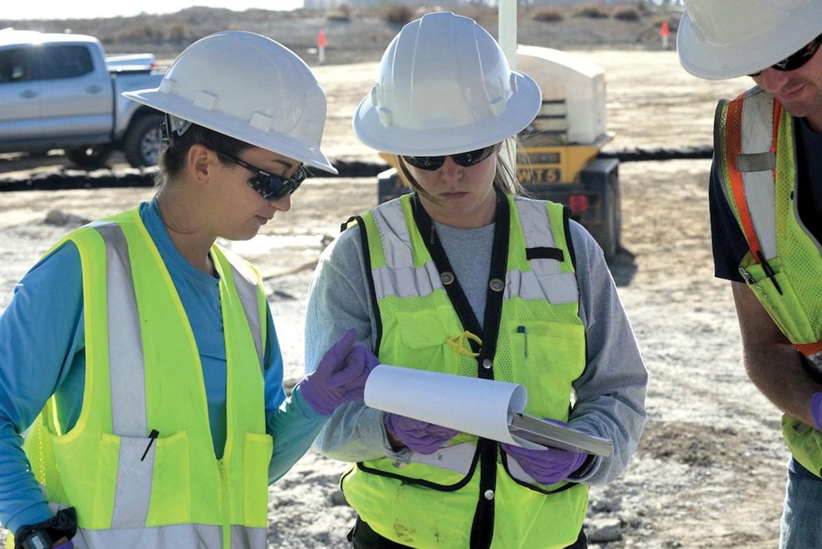 Ascon team members reviewing soil sampling data